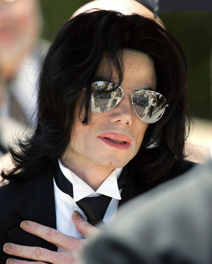 FILE - In this June 13, 2005 photo, Michael Jackson gestures as he leaves court during his trial on child molestation charges in Santa Maria, Calif. Wade Robson, who is now 35, testified at Jackson's criminal trial in 2005 that he had spent many nights in Jackson's room, but Jackson had never molested him. A judge has dismissed the lawsuit brought by Robson, who alleged Jackson molested him as a child. The summary judgment ruling Tuesday, Dec. 19, 2017, against Robson resolves one of the last remaining major claims against the late singer's holdings. (AP Photo/Mark J. Terrill, File) Photo: Mark J. Terrill, Associated Press