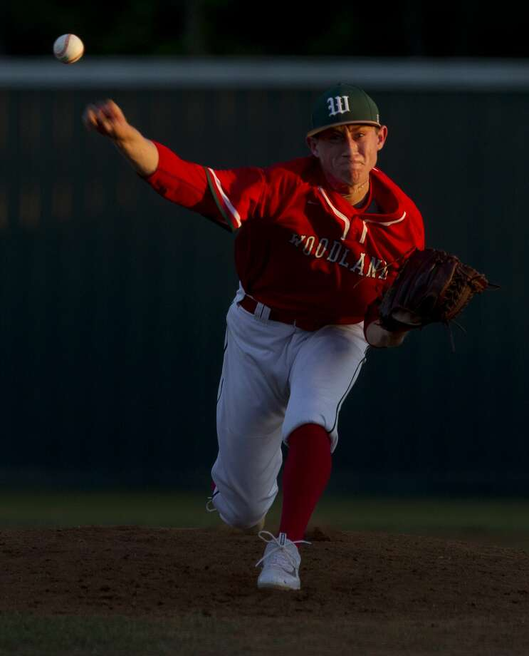 The Woodlands pitcher Devin Fontenot (21) throws during the fourth inning of a District 12-6A high school baseball game Tuesday, March 21, 2017, in Conroe. Photo: Jason Fochtman/Houston Chronicle