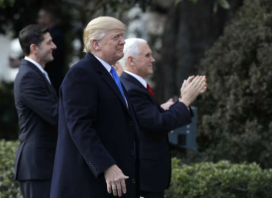 President Donald Trump walks with Vice President Mike Pence and House Speaker Paul Ryan, R-Wis., for a event after final passage of the tax overhaul plan, on the South Lawn of the White House, Wednesday, Dec. 20, 2017, in Washington. (AP Photo/Evan Vucci) Photo: Evan Vucci/AP