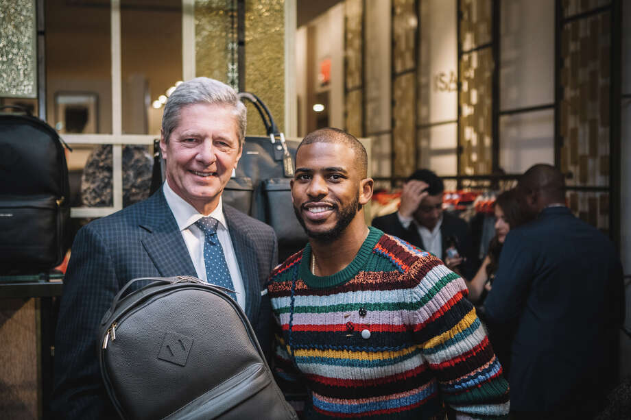 Houston Rockets' Chris Paul with Saks Fifth Avenue Galleria manager Bobby Dees.  (All photos by Carl Sullivan)  Photo: Saks Fifth Avenue