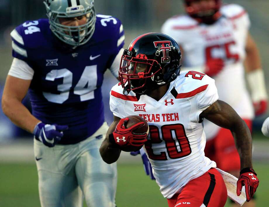 Texas Tech wide receiver Keke Coutee (20) runs for a touchdown past Kansas State defensive end Tanner Wood (34) during the first half of an NCAA college football game in Manhattan, Kan., Saturday, Oct. 8, 2016. (AP Photo/Orlin Wagner) Photo: Orlin Wagner, STF / Internal