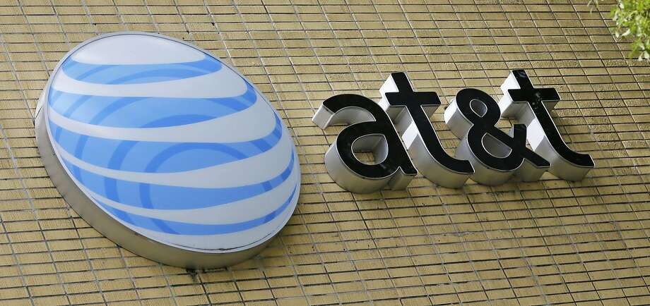 FILE - This Thursday, Oct. 12, 2017, file photo shows an AT&T sign at a store in Miami.  Photo: Alan Diaz, Associated Press
