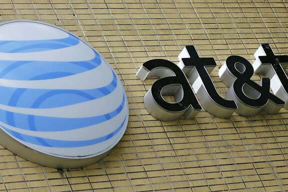 "FILE - This Thursday, Oct. 12, 2017, file photo shows an AT&T sign at a store in Miami. Now that federal telecom regulators have repealed net neutrality, it may be time to brace for the arrival of internet ""fast lanes"" and ""slow lanes."" The Associated Press queried seven major internet providers about their post-net-neutrality plans, and all of them equivocated when asked if they might establish fast and slow lanes. (AP Photo/Alan Diaz, File)"