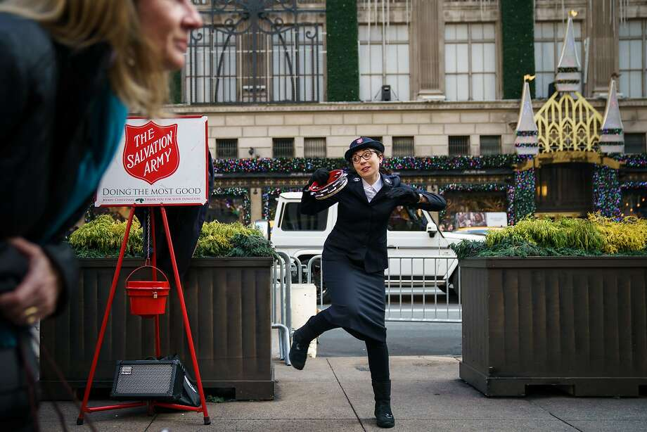 NEW YORK, NY - DECEMBER 18: A member of the Salvation Army sings and dances along Fifth Avenue in Midtown Manhattan, December 18, 2017 in New York City.  The city is decked out in holiday spirit with Christmas one week away from today. (Photo by Drew Angerer/Getty Images) *** BESTPIX *** Photo: Drew Angerer