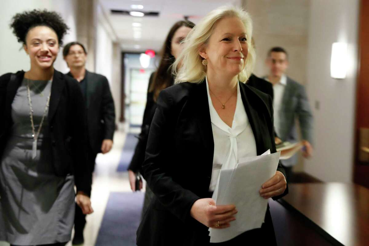 Sen. Kirsten Gillibrand, D-N.Y., right, arrives for a news conference on sexual harassment in the workplace, Wednesday, Dec. 6, 2017, on Capitol Hill in Washington. (AP Photo/Jacquelyn Martin) ORG XMIT: DCJM106
