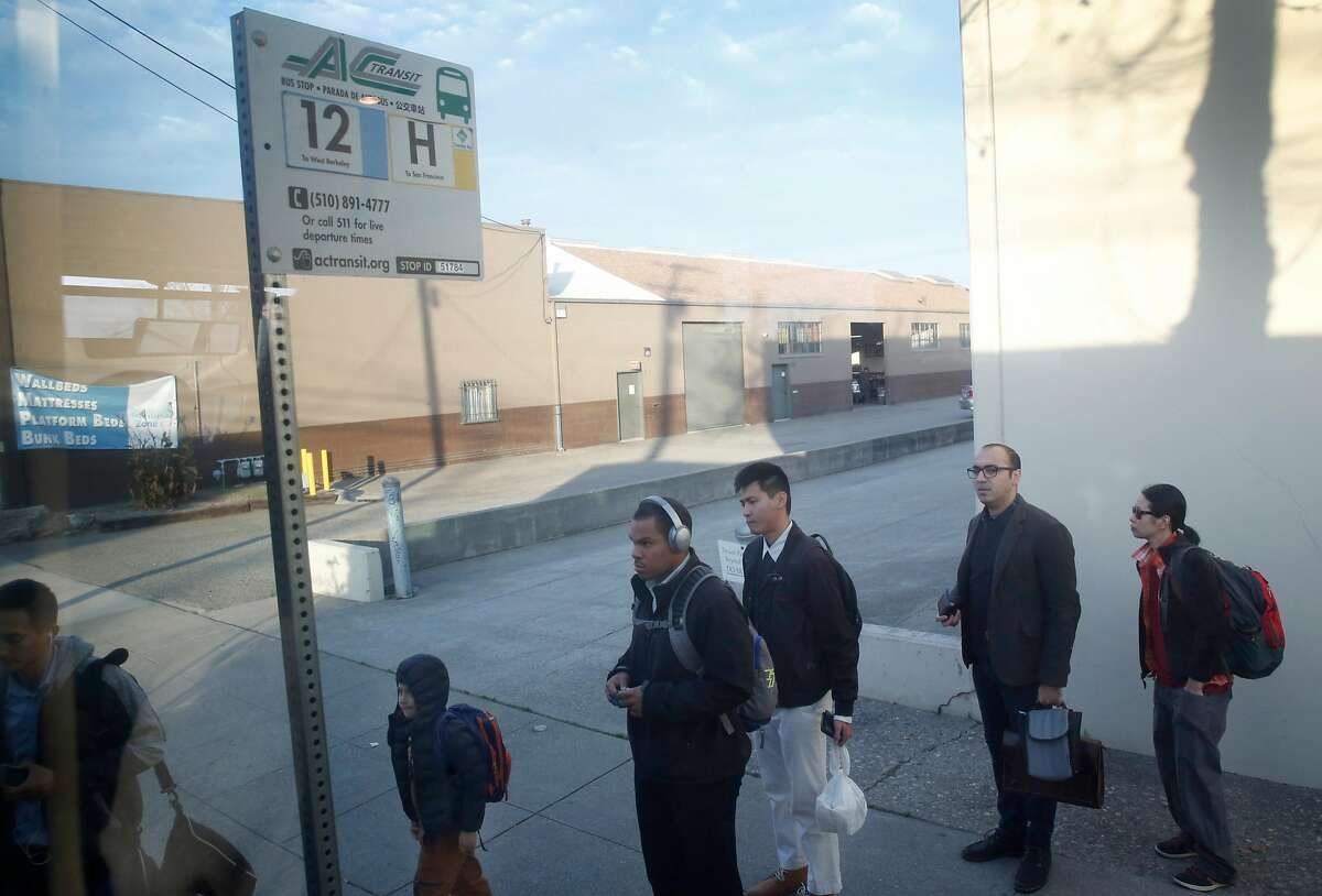 Commuters on Gilman Street in Berkeley board an AC Transit H-line Transbay bus to San Francisco, Calif. on Tuesday, Dec. 19, 2017.