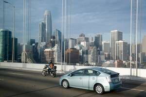 The Salesforce Tower is a dominant presence on the landscape for passengers aboard cars, motorcycles and an AC Transit H-line Transbay commuter bus as traffic on the Bay Bridge approaches San Francisco, Calif. on Tuesday, Dec. 19, 2017.