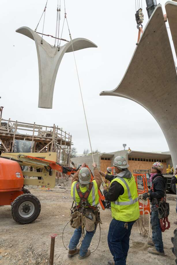 Workers piece together the last petal structure at Confluence Park on Dec. 5, 2017. Photo: San Antonio River Foundation
