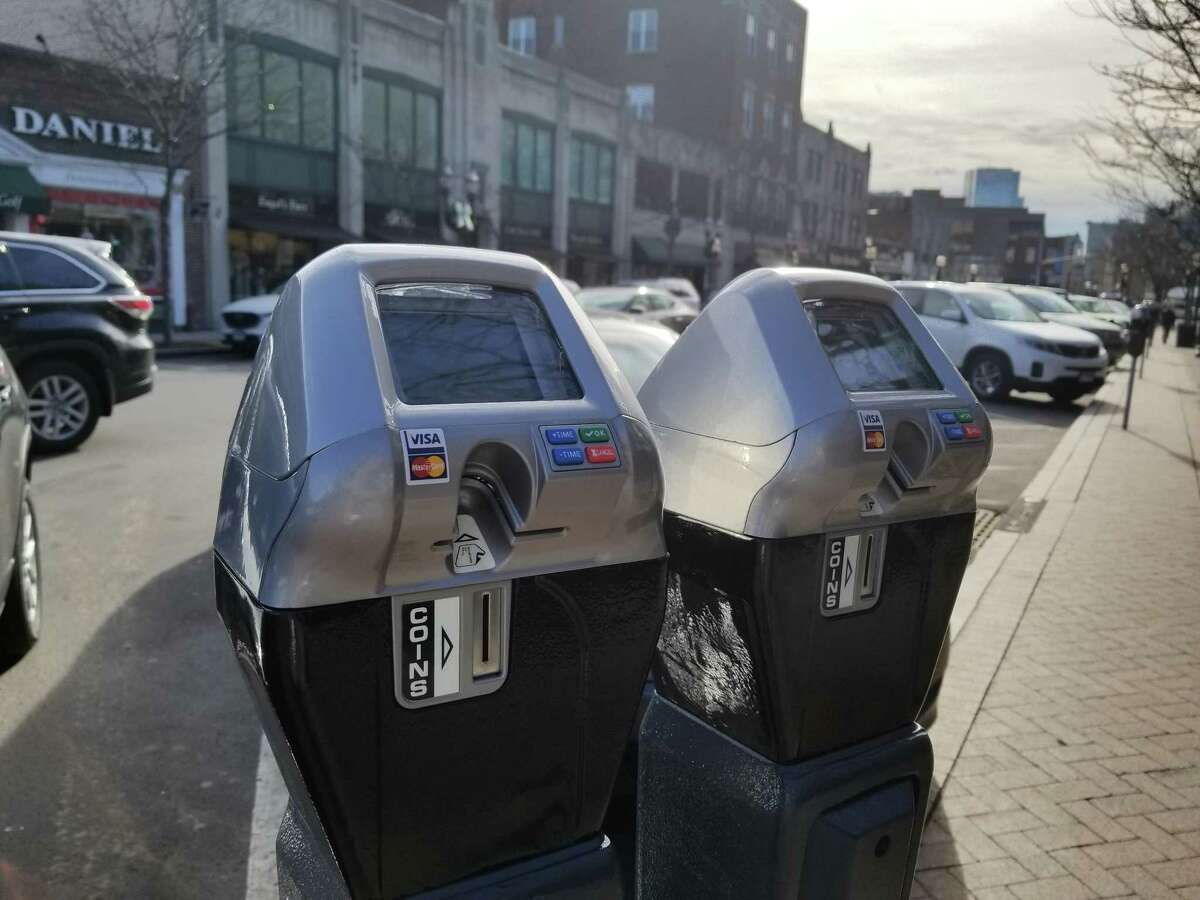Proposed fees by Mayor David Martin target downtown parking, where on-street meters and city garages charge $1 an hour.