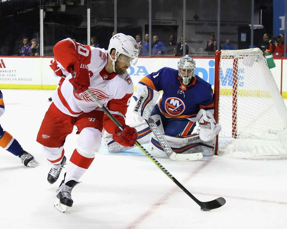 NEW YORK, NY - DECEMBER 19: Henrik Zetterberg #40 of the Detroit Red Wings backhand sthe puck in front of Thomas Greiss #1 of the New York Islanders during the third period at the Barclays Center on December 19, 2017 in the Brooklyn borough of New York City. The Red Wings defeated the Islanders 6-3. (Photo by Bruce Bennett/Getty Images) Photo: Bruce Bennett / Getty Images / 2017 Getty Images