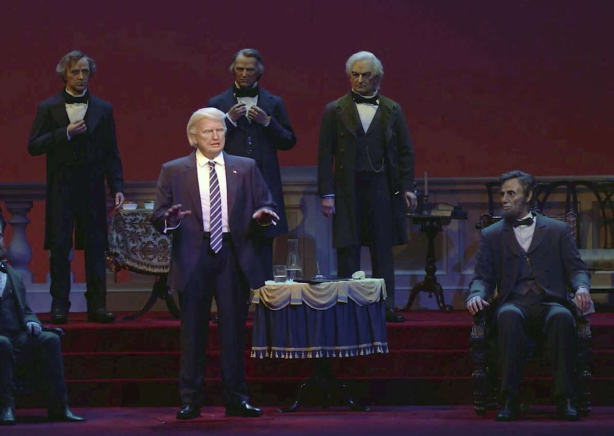 This undated video screen shot provided by Walt Disney World shows an animatronic figure of Donald Trump, center front, at the Hall of Presidents attraction at Walt Disney World in Orlando, Fla.