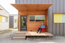 Dallas created a permanent cottage village of 50 tiny houses to house long-term homeless residents.