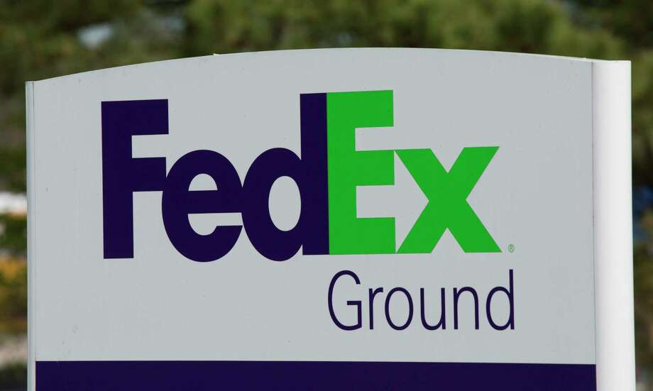 This Tuesday, April 18, 2017, photo, shows a FedEx Ground sign at a warehouse in Ashland, Va. FedEx Corp. reports earnings Tuesday, Dec. 19, 2017. (AP Photo/Steve Helber) ORG XMIT: VASH414 Photo: Steve Helber / Copyright 2017 The Associated Press. All rights reserved.