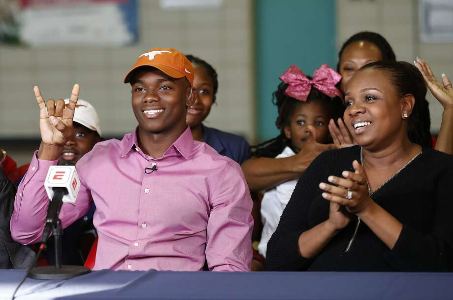 Anthony Cook of Lamar, one of the state's top football recruits, makes his announcement that he will be attending The Univeristy of Texas during a live televised announcement at Lamar High School, Wednesday, Dec. 20, 2017, in Houston.   ( Karen Warren / Houston Chronicle ) Photo: Karen Warren, Houston Chronicle