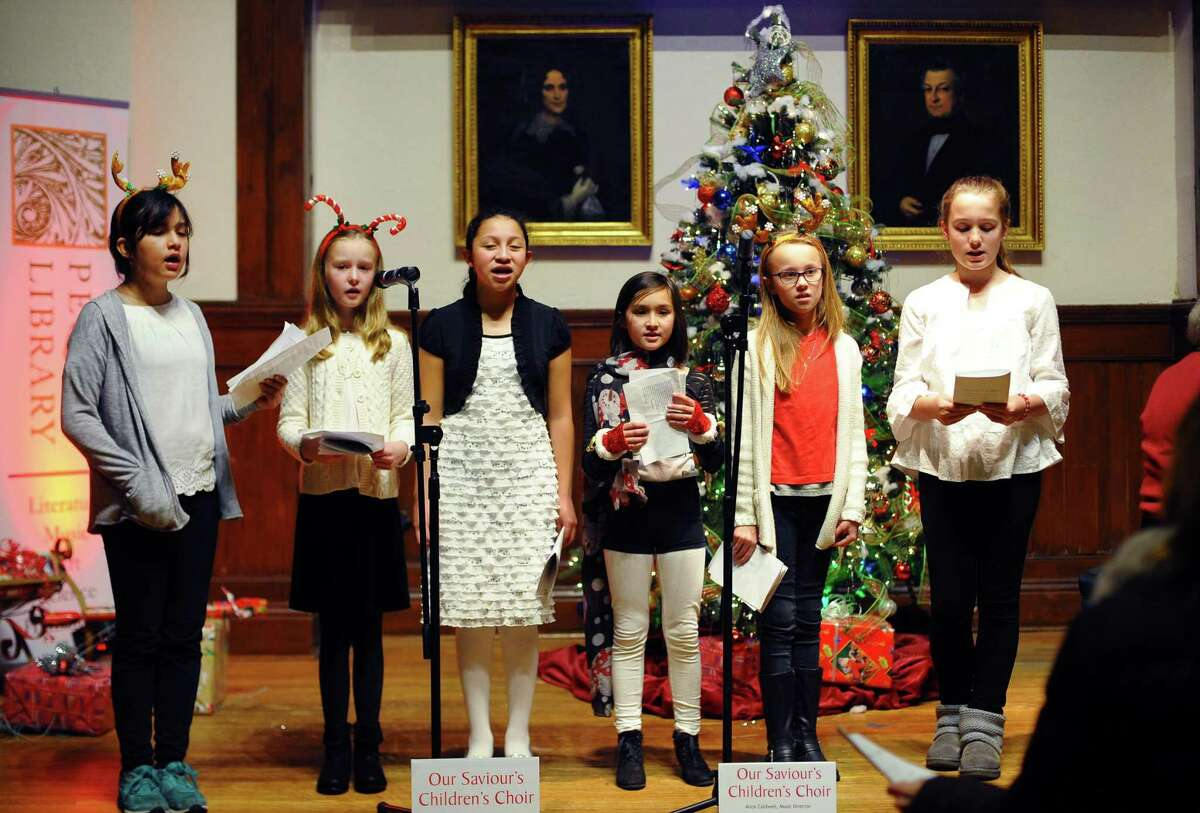The Our Saviour's Children's Choir from Our Saviour's Lutheran Church performs during Pequot Library's New England Holiday Caroling Party and Open House in Southport, Conn., on Friday, December 15, 2017. From left to right is Natalie Compare, 11, Sloane Dwyer, 9, Samara Negrin, 11, Audrey Compare, 9, Emilia Onofrio, 9, and Dagny Dahl, 11. The party featured horse-drawn carriage rides through Southport Village, the choir from both St. Thomas Aquinas Parish, crafts and cookie decorating for youngsters, seasonal beverages for adults and children, ice sculptures by Ice Matters and a warming fire.
