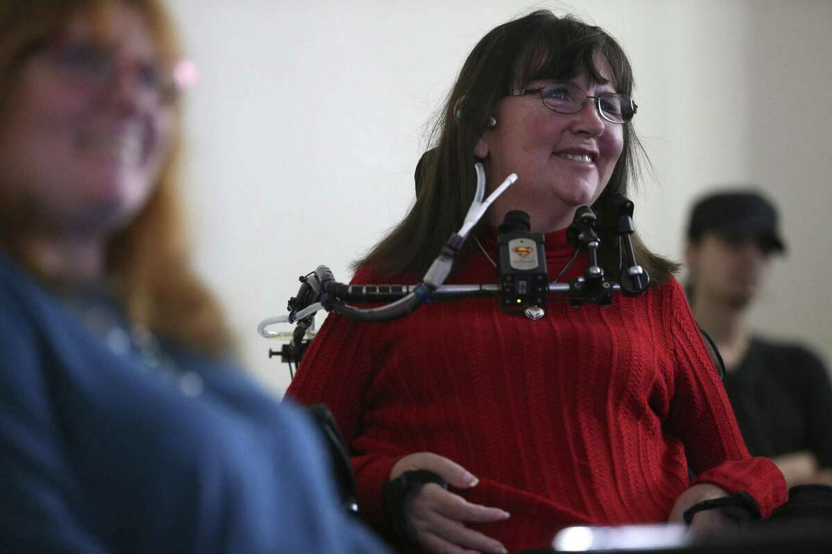 Anne Robinson, 48, reacts as students explain a game designed for her during a presentation at the University of Texas at San Antonio main campus on Dec. 14. Students were tasked with creating a video game for a disabled vet based on their disability and what he or she likes. Robinson is a quadriplegic.