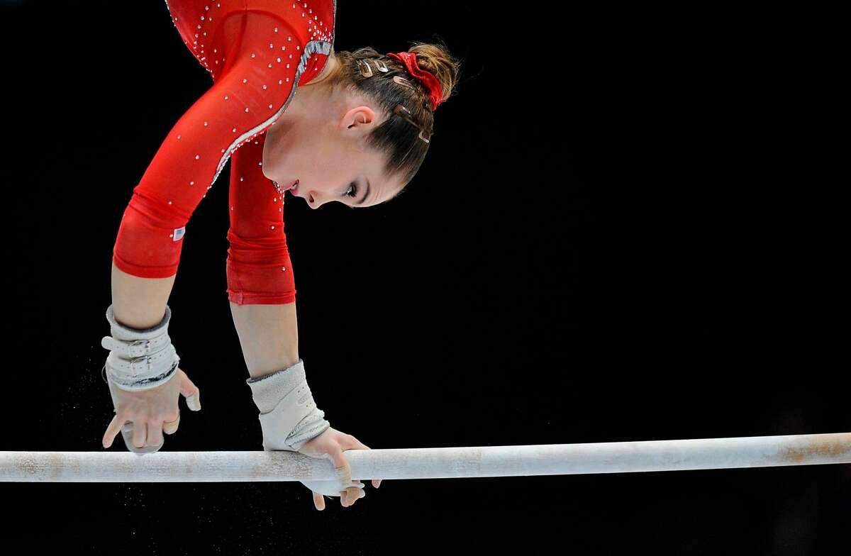 """(FILES) This file photo taken on October 2, 2013 shows US gymnast McKayla Maroney as she competes on uneven bars during the 44th Artistic Gymnastics World Championships in Antwerp. Olympic gymnastics gold medalist McKayla Maroney says the former US team doctor facing child porn and sexual assault charges """"deserves to spend the rest of his life in prison"""". Larry Nassar is scheduled to be sentenced in federal court in Michigan on December 7, 2017 after pleading guilty to child pornography charges. / AFP PHOTO / JOHN THYSJOHN THYS/AFP/Getty Images"""