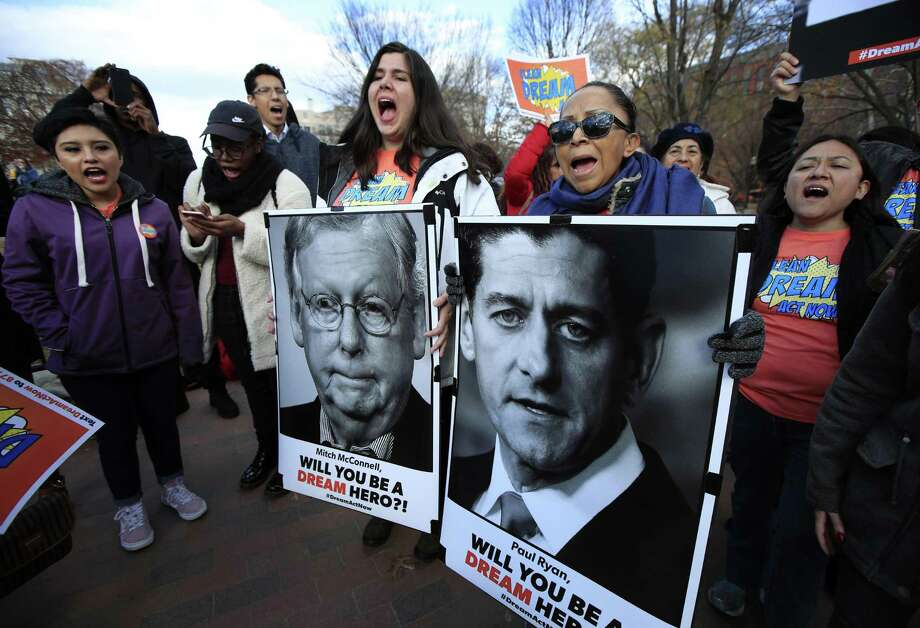 Amanda Bayer, left holding banner, and Marisol Maqueda, right with banner, from Mexico whose daughter Maria Torres also from Mexico City is a DACA recipient finishing her masters degree from Arizona, join a rally outside the White House in Washington, Thursday, Dec. 7, 2017. (AP Photo/Manuel Balce Ceneta). Photo: Manuel Balce Ceneta / Associated Press / Copyright 2017 The Associated Press. All rights reserved.