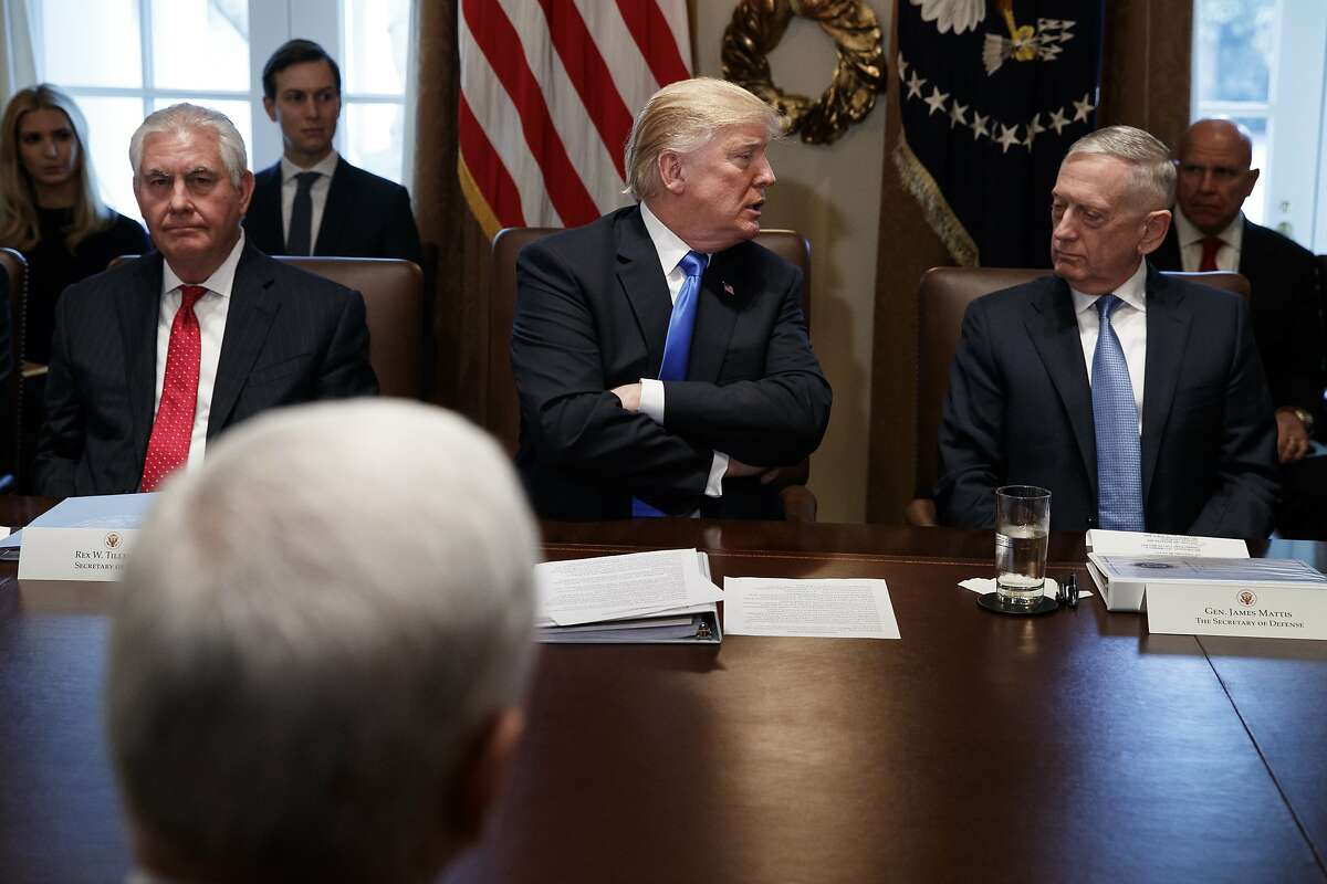 Secretary of State Rex Tillerson, left, and Secretary of Defense Jim Mattis, right, listen as President Donald Trump speaks during a cabinet meeting at the White House, Wednesday, Dec. 20, 2017, in Washington. (AP Photo/Evan Vucci)