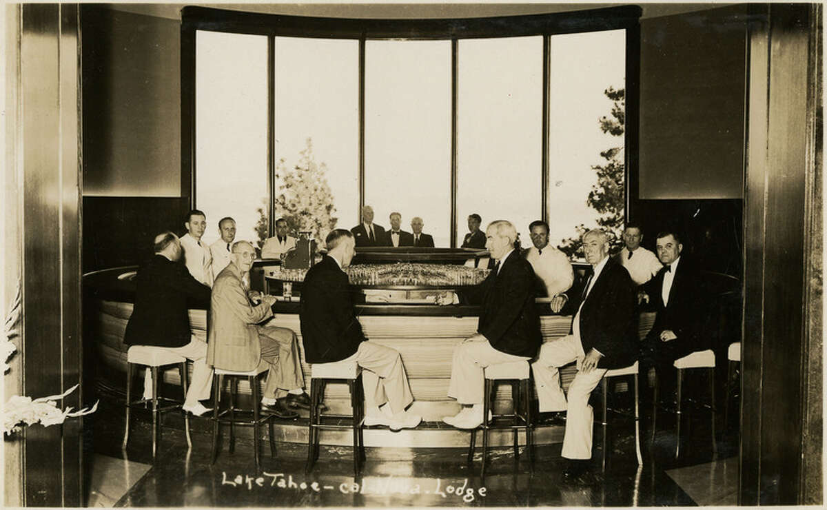 """No Caption: A group of unidentified men standing and seated at a circular bar at the Cal-Neva Lodge, located on the border of California and Nevada, c. 1935. """"McCarthy Album 10, Photograph 352,"""" California State Archives Exhibits, accessed December 20, 2017."""