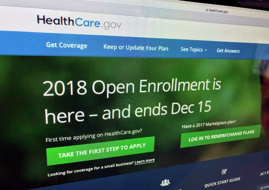 The HealthCare.gov website is photographed in Washington on Dec. 15, 2017. A burst of sign-ups is punctuating the end of a tumultuous year for former President Barack Obama's health care law. Strong consumer interest around Friday's enrollment deadline for 2018 was seen as validation for the program's subsidized individual health insurance. But the Affordable Care Act's troubles aren't over. Even if full repeal now seems off the table, actions by the Republican-led Congress and the Trump administration could undermine the ACA's insurance markets. (AP Photo/Jon Elswick Photo: Jon Elswick, STF / AP