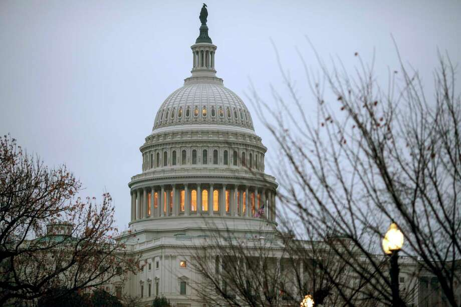 The Capitol is seen in Washington, early Tuesday, Dec. 5, 2017. (AP Photo/J. Scott Applewhite) Photo: J. Scott Applewhite, STF / Copyright 2017 The Associated Press. All rights reserved.