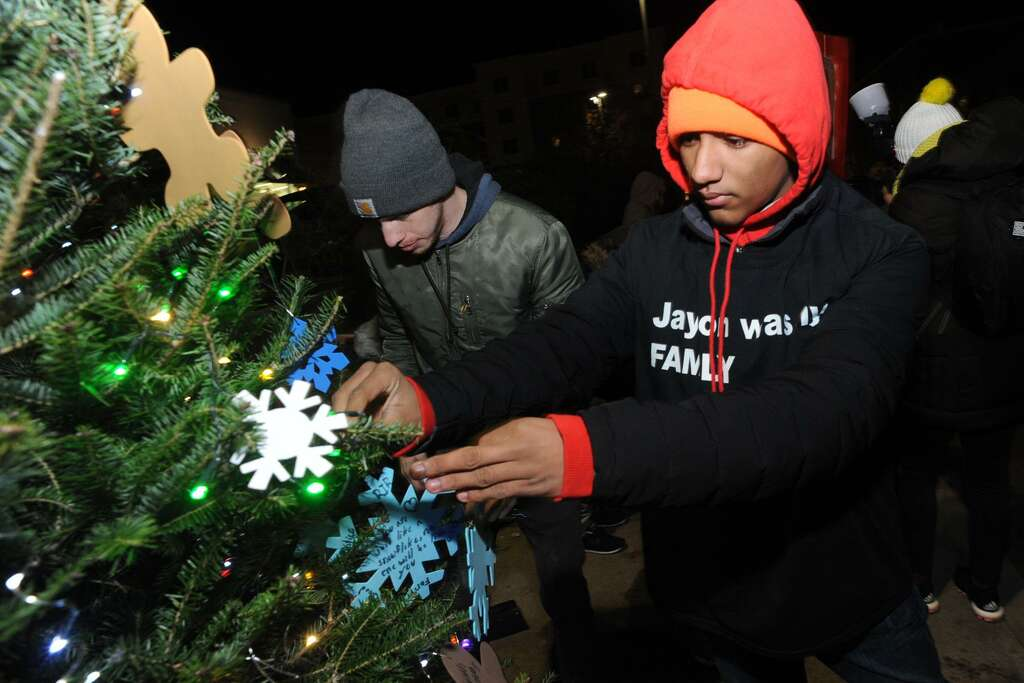 Jovon Mercado of Bridgeport helps decorate a Christmas tree set up near the spot  sc 1 st  Connecticut Post : fairfield christmas tree lighting - azcodes.com