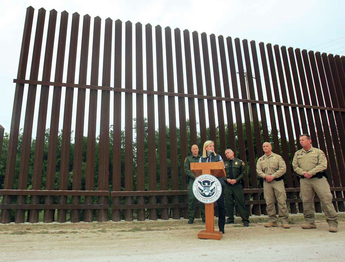 United States Department of Homeland Security Secretary Kirstjen Nielsen speaks to the local news media against the backdrop of the border wall this month in Hidalgo, Texas. The new head of the U.S. Department of Homeland Security says she hopes construction on a border wall will begin soon. (Joel Martinez/The Monitor via AP)