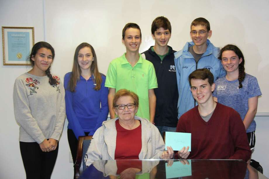 Dylan Karpel (seated, right) jumped into the Coginchaug River recently to save Bernadette Graham's (seated, left) dog, Rex. Karpel was on a practice run for the Middletown High School indoor track team. Standing, from left, are Bernadette Graham Alexa Gonzalez, Ariana Monarca, Konstantin Ditc, Michael Katz, Matt Lecky and Nicole Nenninger, also members of the team who helped to save Rex. Photo: Jennifer Price Photo