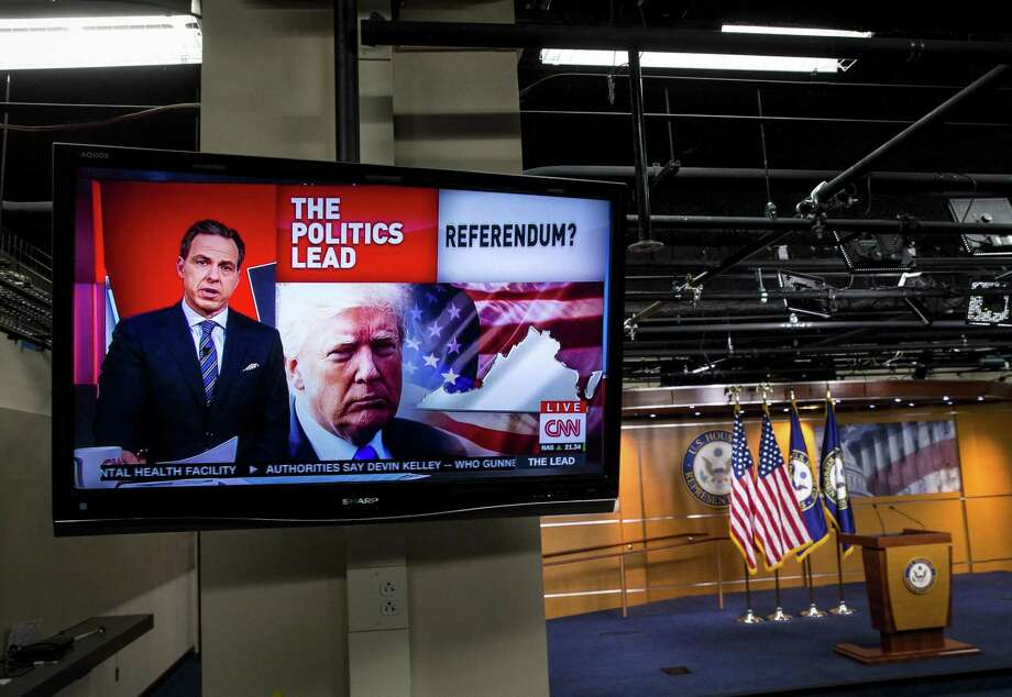 FILE -- A television plays Jake Tapper on CNN in the House studio on Capitol Hill in Washington, Nov. 8, 2017. President Vladimir Putin signed a law in November of 2017 that requires select American media outlets in Russia to register with the government as foreign agents, essentially identifying them as hostile outfits. (Al Drago/The New York Times) Photo: AL DRAGO / Al Drago / New York Times / NYTNS