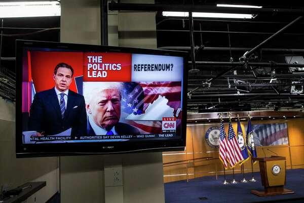 FILE -- A television plays Jake Tapper on CNN in the House studio on Capitol Hill in Washington, Nov. 8, 2017. President Vladimir Putin signed a law in November of 2017 that requires select American media outlets in Russia to register with the government as foreign agents, essentially identifying them as hostile outfits. (Al Drago/The New York Times)