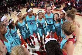 Stanford women's basketball team talk at half court following a win over CSU Bakersfield 57-34 at Maples Pavilion. Stanford wore turquoise uniforms to celebrate Native American Heritage Month.