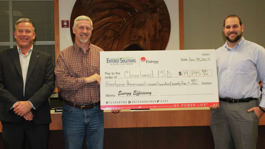 Entergy representatives, Rick LaFleur and Mark Delavan, present a Certificate of Recognition and check in the amount of $14,795.84 to Cleveland ISD School Board President Mr. Chris Wood for Cleveland ISD's recent energy efficiency accomplishments in the Entergy Solutions Program. Photo: Submitted