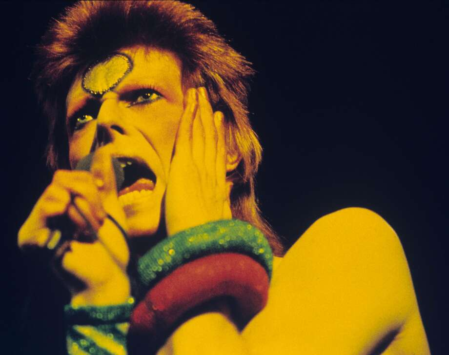 David Bowie performs during the Ziggy Stardust tour in London. Photo: Gijsbert Hanekroot, Redferns
