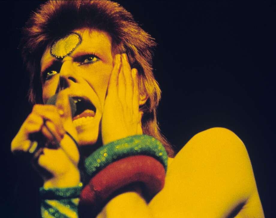 David Bowie performs during the Ziggy Stardust tour in London. Photo: Gijsbert Hanekroot, Redferns