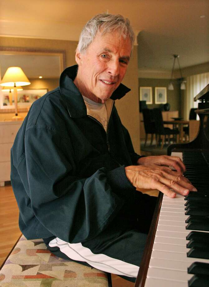 """Burt Bacharach, winner of three Oscars and six Grammys, is seen in his hotel room in New York October 10, 2005. The legendary, 77-year-old composer has found his voice in a politically charged album """"At This Time"""" that features his first lyrics ever in a nearly 50-year career creating some of pop music's best-known love songs. Picture taken October 10, 2005. To accompany feature LEISURE BACHARACH. REUTERS/Erin Siegal  Ran on: 11-06-2005 Bert Bacharach: The Oscar- and Grammy-winning composer of numerous love songs has now made a protest album. Photo: ERIN SIEGAL, REUTERS"""