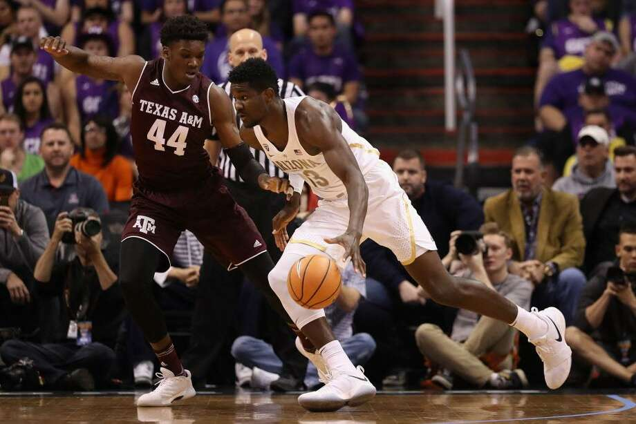 Arizona's Deandre Ayton drives the ball against Texas A&M's Robert Williams during a Dec. 5 game. Photo: Christian Petersen / Getty Images / 2017 Getty Images