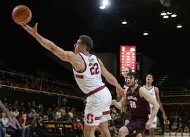 Stanford forward Reid Travis (22) reaches for a high pass during the second half of an NCAA college basketball game against Montana on Wednesday, Nov. 29, 2017, in Stanford, Calif. (AP Photo/Marcio Jose Sanchez)