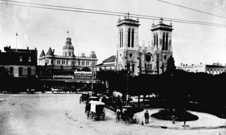 Main Plaza, circa 1892. Left to right: the Southern Hotel, the towers of City Hall above the Hole in the Wall Restaurant, San Fernando Cathedral and Frost National Bank. The oldest part of the Cathedral was built 1738-49, but the Gothic facade was not completed until 1873. Photo: Raba Collection /San Antonio Conservation Society Foundation / San Antonio Conservation Society