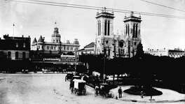 Main Plaza, circa 1892. Left to right: the Southern Hotel, the towers of City Hall above the Hole in the Wall Restaurant, San Fernando Cathedral and Frost National Bank. The oldest part of the Cathedral was built 1738-49, but the Gothic facade was not completed until 1873.