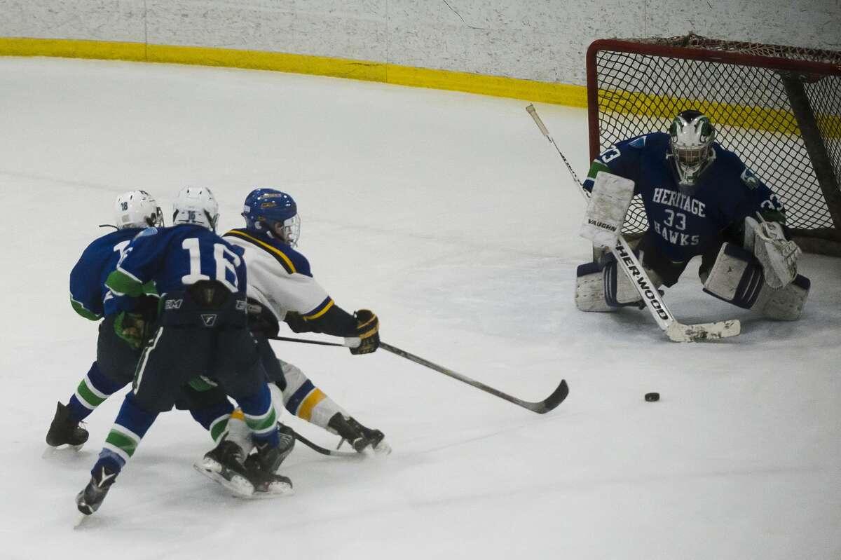 Midland sophomore Matthew Babinski takes a shot on goal during the Chemics' game against Saginaw Heritage on Wednesday, Dec. 20, 2017 at Midland Civic Arena. (Katy Kildee/kkildee@mdn.net)