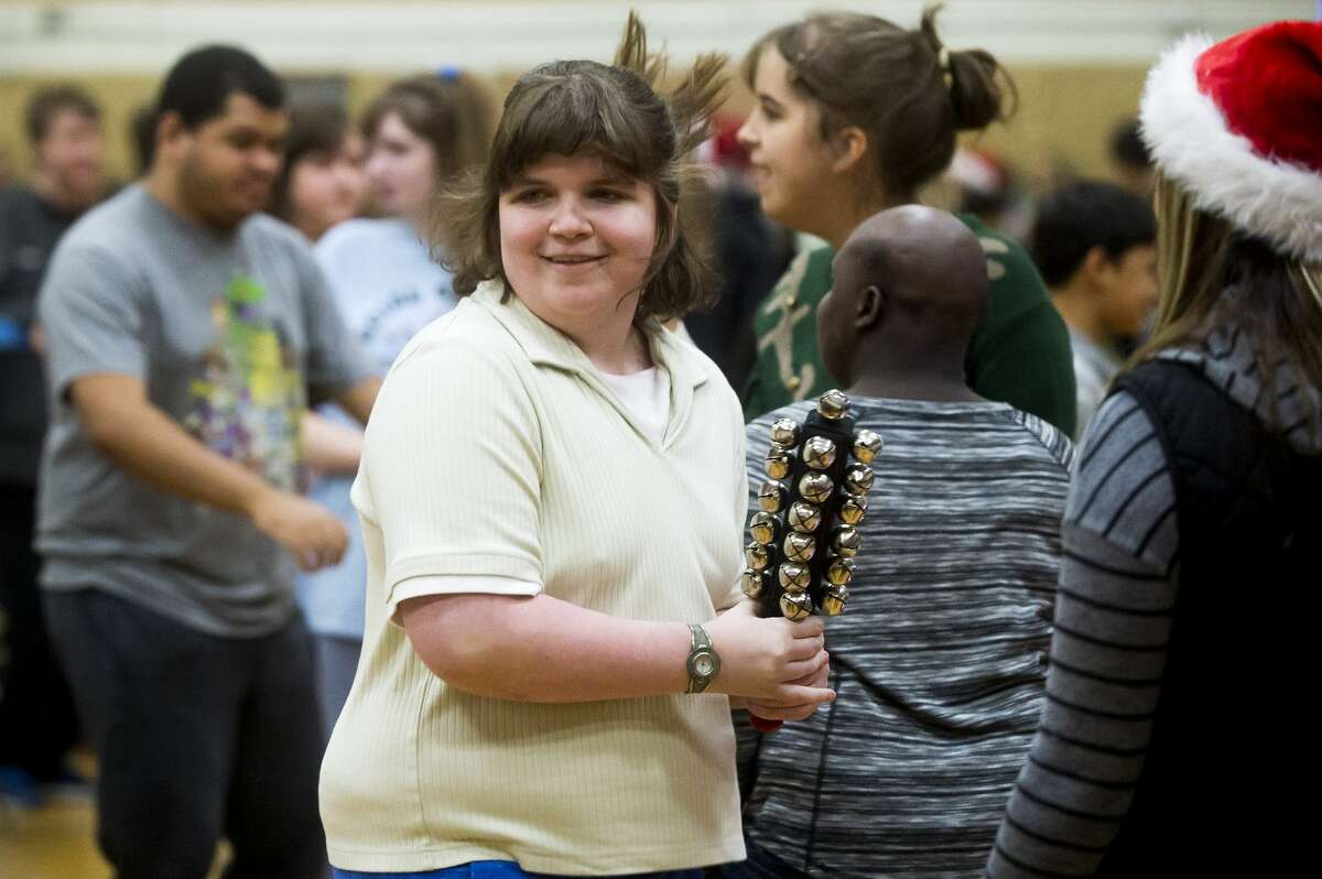 Sidney Wallace dances and plays the bells during the All Music is Power concert on Tuesday, Dec. 19, 2017 at the Midland County Educational Service Agency. All Music is Power provides concerts for children with special needs to encourage movement and expression. (Katy Kildee/kkildee@mdn.net)