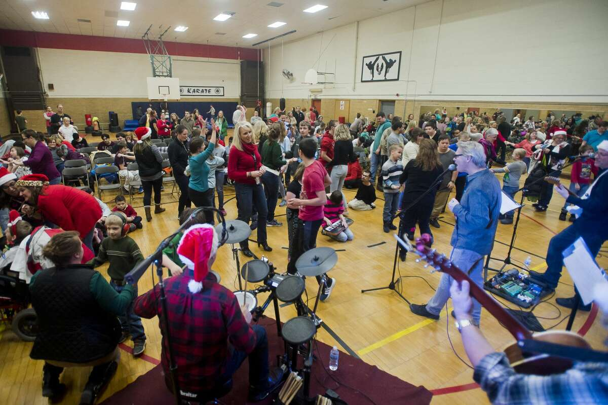Students and faculty dance along to Christmas songs and other hits during the All Music is Power concert on Tuesday, Dec. 19, 2017 at the Midland County Educational Service Agency. All Music is Power provides concerts for children with special needs to encourage movement and expression. (Katy Kildee/kkildee@mdn.net)