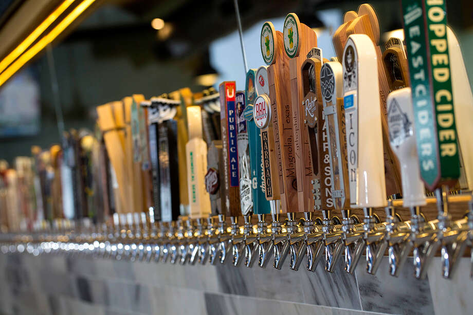Growler USA offers up to 100 taps of craft beer, hard cider and draught wine and a variety of food options. It will soon have two Houston-area locations.  Photo: Growler USA