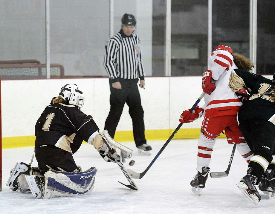 Delaney Roth of Greenwich, right, gets off a shot as Trumbull - St. Joseph goalie Tory Coffin attempts to make a stop during the girls high school ice hockey game between Greenwich High School and Trumbull - St. Joseph combined High Schools at Hamill Rink in Greenwich, Conn., Wednesday night, Dec. 20, 2017. Photo: Bob Luckey Jr. / Hearst Connecticut Media / Greenwich Time