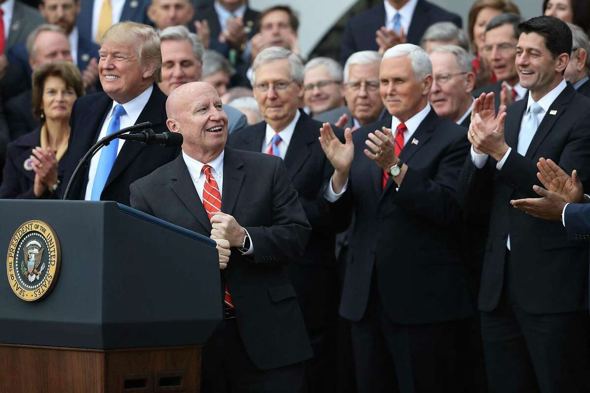 WASHINGTON, DC - DECEMBER 20: House Ways and Means Committee Chairman Kevin Brady (R-TX) (2nd L) delivers remarks during an event to celebrate Congress passing the Tax Cuts and Jobs Act with (L-R) President Donald Trump, Senate Majority Leader Mitch McConnell (R-KY), Vice President Mike Pence, Speaker of the House Paul Ryan (R-WI) and fellow Republican members of the House and Senate on the South Lawn of the White House December 20, 2017 in Washington, DC. The tax bill is the first major legislative victory for the GOP-controlled Congress and Trump since he took office almost one year ago. (Photo by Chip Somodevilla/Getty Images)