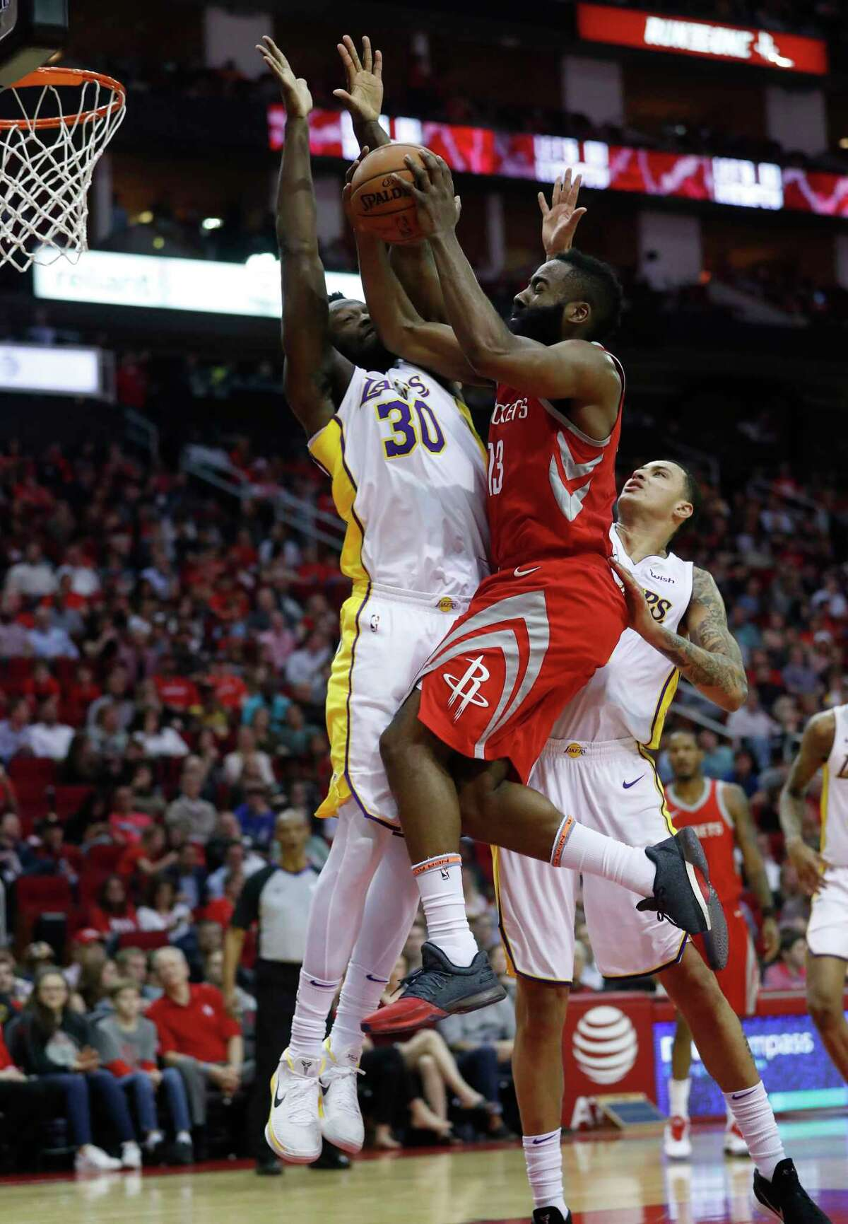 Houston Rockets guard James Harden (13) goes up for the shot against Los Angeles Lakers forward Julius Randle (30) during the first half of an NBA basketball game at Toyota Center, Wednesday, Dec. 20, 2017, in Houston.