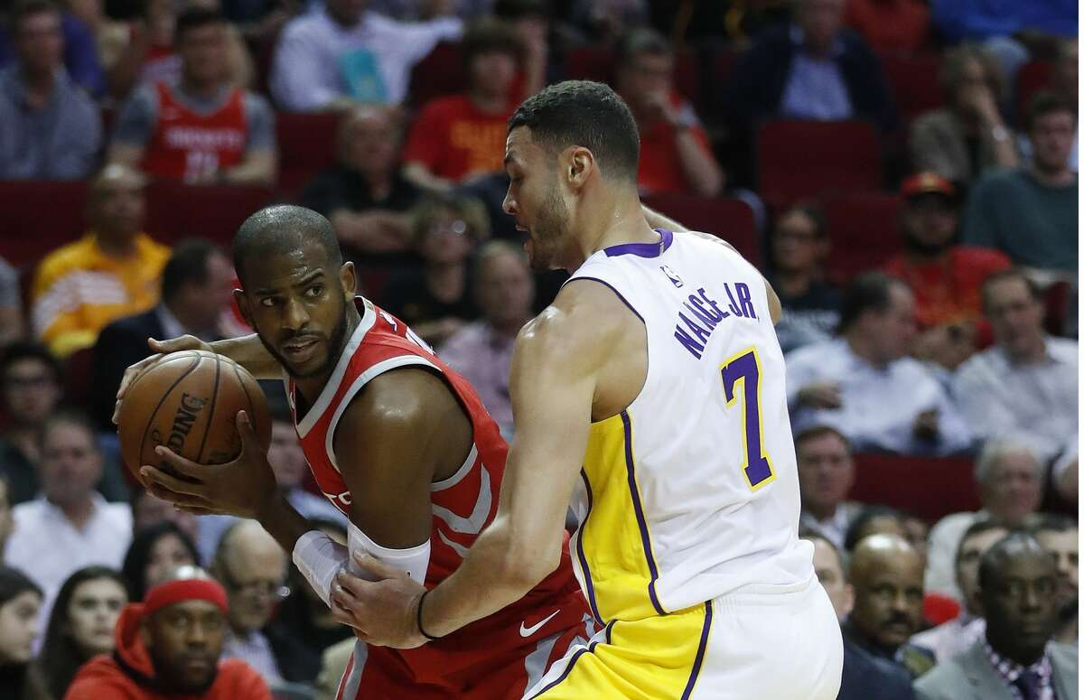 Houston Rockets guard Chris Paul (3) tries to get past Los Angeles Lakers forward Larry Nance Jr. (7) during the first half of an NBA basketball game at Toyota Center, Wednesday, Dec. 20, 2017, in Houston. ( Karen Warren / Houston Chronicle )