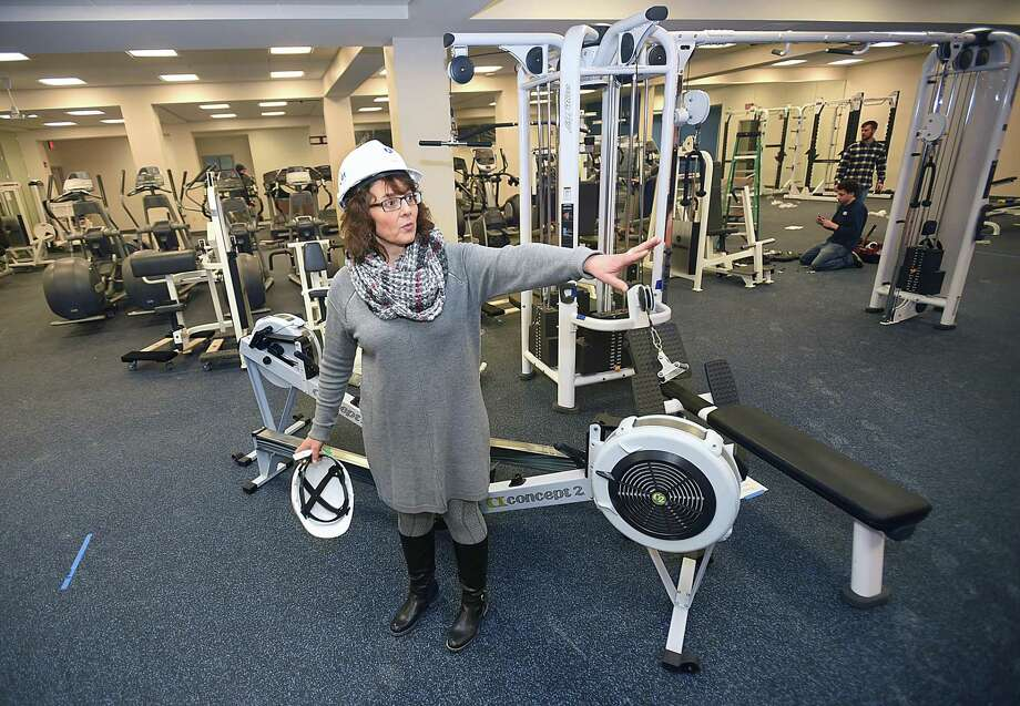 Judy Alperin, chief executive officer of JCC of Greater New Haven, gives a tour of the fitness center at the Woodbridge facility Wednesday. Photo: Catherine Avalone / Hearst Connecticut Media / New Haven Register