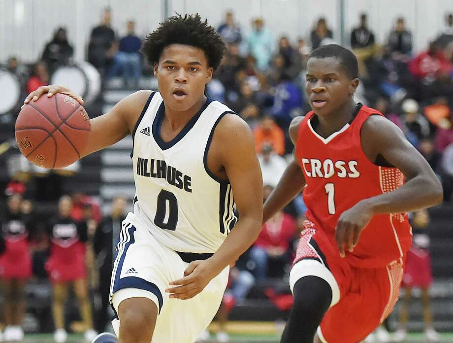 Hillhouse sophomore guard Aiden Roundtree drives past Wilbur Cross junior Enasj Jones in the fourth quarter of the cross-town rivalry at the Floyd Little Athletic Complex, Wednesday, Dec. 20, 2017. Hillhouse won,  77-69. Photo: Catherine Avalone, Hearst Connecticut Media / New Haven Register